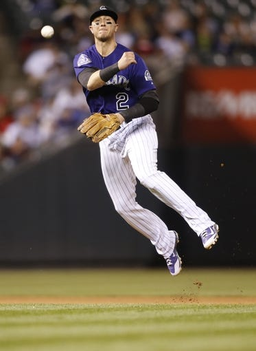 Sep 24, 2013; Denver, CO, USA; Colorado Rockies shortstop Troy Tulowitzki (2) fields a ground ball during the fifth inning against the Boston Red Sox at Coors Field. Mandatory Credit: Chris Humphreys-USA TODAY Sports