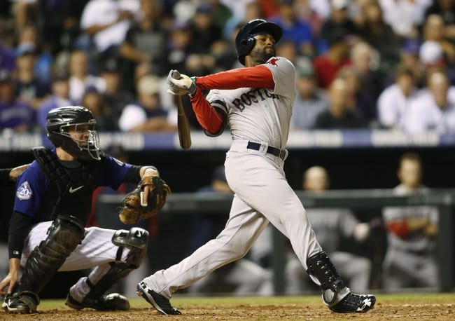 Sep 24, 2013; Denver, CO, USA; Boston Red Sox center fielder Jackie Bradley Jr. (25) hits a single during the fifth inning against the Colorado Rockies at Coors Field. Mandatory Credit: Chris Humphreys-USA TODAY Sports