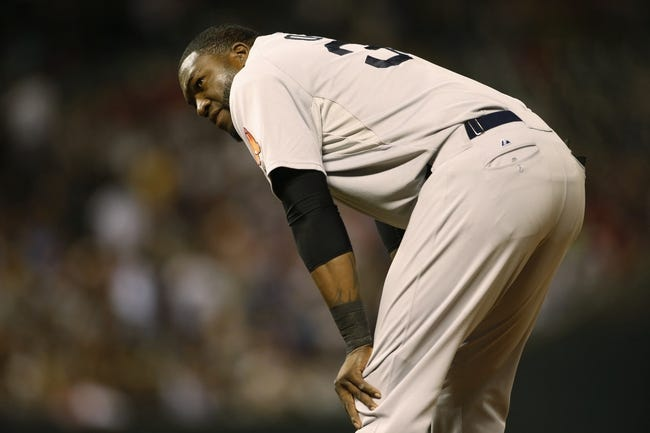Sep 24, 2013; Denver, CO, USA; Boston Red Sox first baseman David Ortiz (34) reacts after getting out during the sixth inning against the Colorado Rockies at Coors Field. Mandatory Credit: Chris Humphreys-USA TODAY Sports