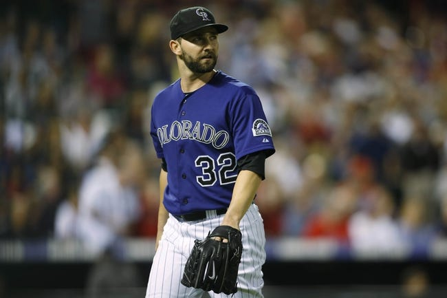 Sep 24, 2013; Denver, CO, USA; Colorado Rockies pitcher Tyler Chatwood (32) walks off the field during the fifth inning against the Boston Red Sox at Coors Field. Mandatory Credit: Chris Humphreys-USA TODAY Sports