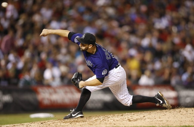 Sep 24, 2013; Denver, CO, USA; Colorado Rockies starting pitcher Tyler Chatwood (32) delivers a pitch during the sixth inning against the Boston Red Sox at Coors Field. Mandatory Credit: Chris Humphreys-USA TODAY Sports