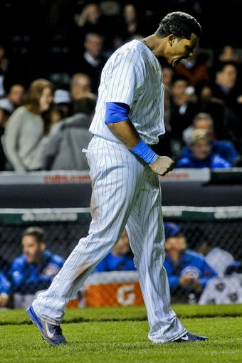 Sep 24, 2013; Chicago, IL, USA;  Chicago Cubs infielder Starlin Castro reacts after striking out against the Pittsburgh Pirates in the seventh inning of their game against the Pittsburgh Steelers at Wrigley Field. Mandatory Credit: Matt Marton-USA TODAY Sports