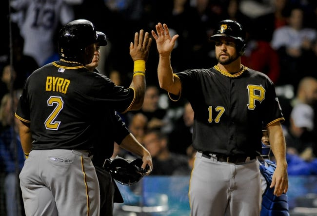 Sep 24, 2013; Chicago, IL, USA;  Pittsburgh Pirates infielder Gaby Sanchez is congratulated from outfielder Marlon Byrd after he scores against the Chicago Cubs in the second inning at Wrigley Field. Mandatory Credit: Matt Marton-USA TODAY Sports