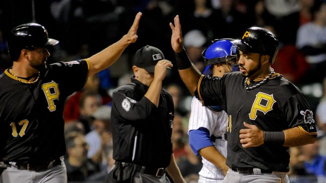 Sep 24, 2013; Chicago, IL, USA;  Pittsburgh Pirates infielder Pedro Alvarez is congratulated from infielder Gabby Sanchez after he scores against the Chicago Cubs in the second inning at Wrigley Field. Mandatory Credit: Matt Marton-USA TODAY Sports
