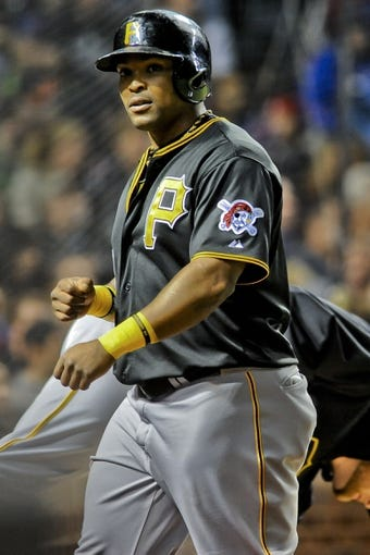 Sep 24, 2013; Chicago, IL, USA;  Pittsburgh Pirates infielder Marlon Byrd scores in the fifth inning of their game against the Chicago Cubs at Wrigley Field. Mandatory Credit: Matt Marton-USA TODAY Sports