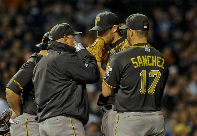 Sep 24, 2013; Chicago, IL, USA; Pittsburgh Pirates pitcher Gerrit Cole talks with catcher Russell Martin (in jacket) pitching coach Ray Searage and infielder Gaby Sanchez during their game against the Chicago Cubs at Wrigley Field. Mandatory Credit: Matt Marton-USA TODAY Sports