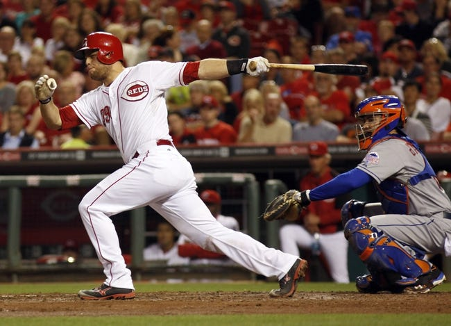 Sep 24, 2013; Cincinnati, OH, USA; Cincinnati Reds catcher Devin Mesoraco bats during a game against the New York Mets at Great American Ball Park. Mandatory Credit: David Kohl-USA TODAY Sports