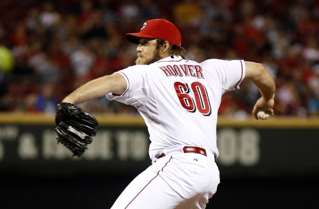 Sep 24, 2013; Cincinnati, OH, USA; Cincinnati Reds relief pitcher J.J. Hoover throws against the New York Mets in the seventh inning at Great American Ball Park. Mandatory Credit: David Kohl-USA TODAY Sports