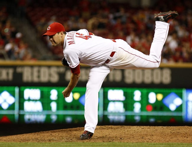 Sep 24, 2013; Cincinnati, OH, USA; Cincinnati Reds relief pitcher Sean Marshall releases a pitch against the New York Mets in the eighth inning at Great American Ball Park. Mandatory Credit: David Kohl-USA TODAY Sports
