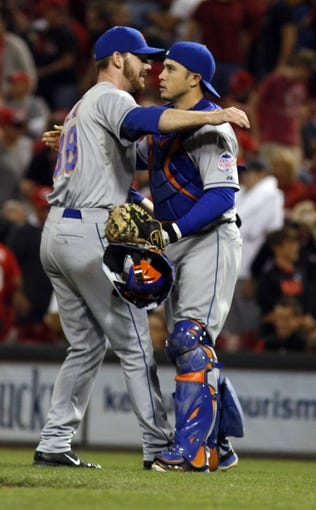Sep 24, 2013; Cincinnati, OH, USA; New York Mets relief pitcher Vic Black (38) is congratulated by catcher Travis d'Arnaud (15) after the Mets beat the Reds 4-2 at Great American Ball Park. Mandatory Credit: David Kohl-USA TODAY Sports