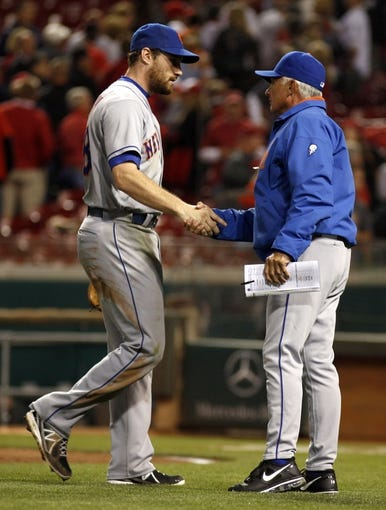 Sep 24, 2013; Cincinnati, OH, USA; New York Mets manager Terry Collins (right) shakes hand with second baseman Daniel Murphy (left) after the Mets beat the Cincinnati Reds 4-2 at Great American Ball Park. Mandatory Credit: David Kohl-USA TODAY Sports