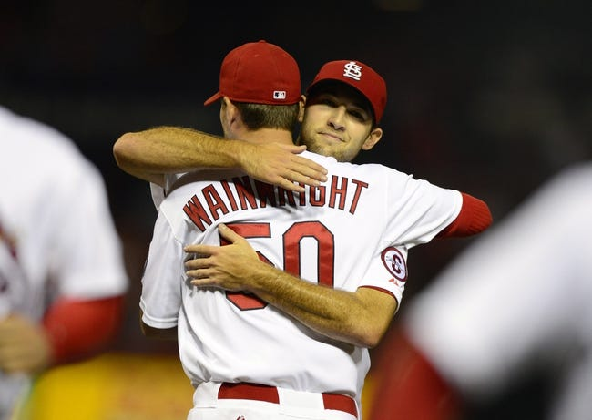 Sep 24, 2013; St. Louis, MO, USA; St. Louis Cardinals starting pitcher Michael Wacha (52) celebrates with starting pitcher Adam Wainwright (50) after a game against the Washington Nationals at Busch Stadium. Wacha threw 8.2 innings allowing one hit and striking out nine as St. Louis defeated Washington 2-0. Mandatory Credit: Jeff Curry-USA TODAY Sports