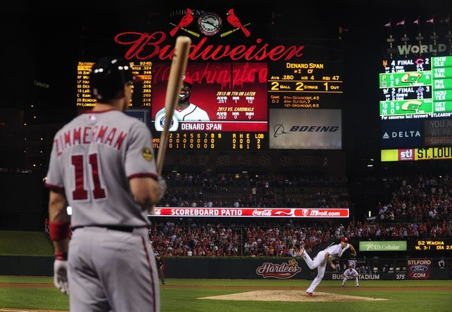 Sep 24, 2013; St. Louis, MO, USA; St. Louis Cardinals starting pitcher Michael Wacha (52) throws to a Washington Nationals batter as third baseman Ryan Zimmerman (11) looks on during the ninth inning at Busch Stadium. Wacha threw 8.2 innings allowing one hit and striking out nine as St. Louis defeated Washington 2-0. Mandatory Credit: Jeff Curry-USA TODAY Sports