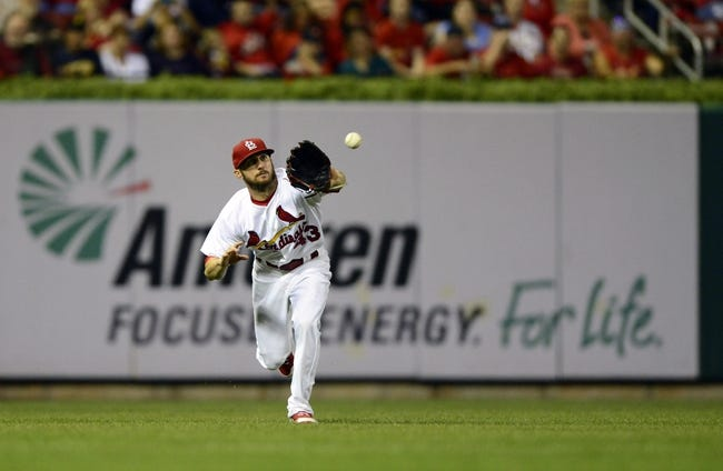 Sep 24, 2013; St. Louis, MO, USA; St. Louis Cardinals right fielder Shane Robinson (43) catches a fly ball hit by Washington Nationals starting pitcher Gio Gonzalez (not pictured) during the sixth inning at Busch Stadium. St. Louis defeated Washington 2-0. Mandatory Credit: Jeff Curry-USA TODAY Sports