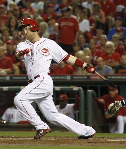 Sep 24, 2013; Cincinnati, OH, USA; Cincinnati Reds third baseman Todd Frazier bats during a game against the New York Mets at Great American Ball Park. Mandatory Credit: David Kohl-USA TODAY Sports