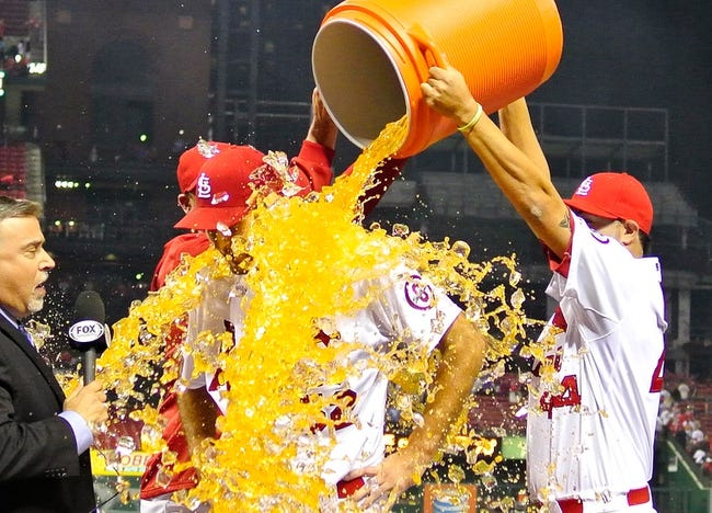 Sep 24, 2013; St. Louis, MO, USA; St. Louis Cardinals starting pitcher Michael Wacha (52) has gatorade dumped on him by relief pitcher John Axford (34) and relief pitcher Edward Mujica (44) after throwing 8.2 innings allowing one hit and striking out nine against the Washington Nationals at Busch Stadium. St. Louis defeated Washington 2-0. Mandatory Credit: Jeff Curry-USA TODAY Sports