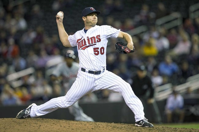 Sep 24, 2013; Minneapolis, MN, USA; Minnesota Twins relief pitcher Casey Fien (50) delivers a pitch in the ninth inning against the Detroit Tigers at Target Field. The Tigers won 4-2. Mandatory Credit: Jesse Johnson-USA TODAY Sports
