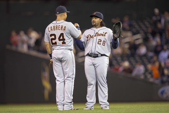 Sep 24, 2013; Minneapolis, MN, USA; Detroit Tigers third baseman Miguel Cabrera (24) and first baseman Prince Fielder (28) celebrate after beating the Minnesota Twins at Target Field. The Tigers won 4-2. Mandatory Credit: Jesse Johnson-USA TODAY Sports