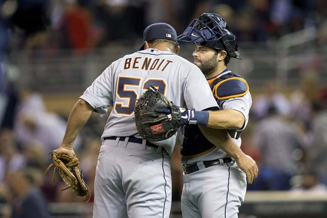 Sep 24, 2013; Minneapolis, MN, USA; Detroit Tigers relief pitcher Joaquin Benoit (53) and catcher Alex Avila (13) celebrate after beating the Minnesota Twins at Target Field. The Tigers won 4-2. Mandatory Credit: Jesse Johnson-USA TODAY Sports