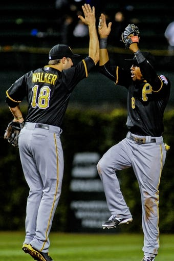 Sep 24, 2013; Chicago, IL, USA;  Pittsburgh Pirates infielder Neil Walker and outfielder Starling Marte high-five after beating the Chicago Cubs 8-2 at Wrigley Field. Mandatory Credit: Matt Marton-USA TODAY Sports