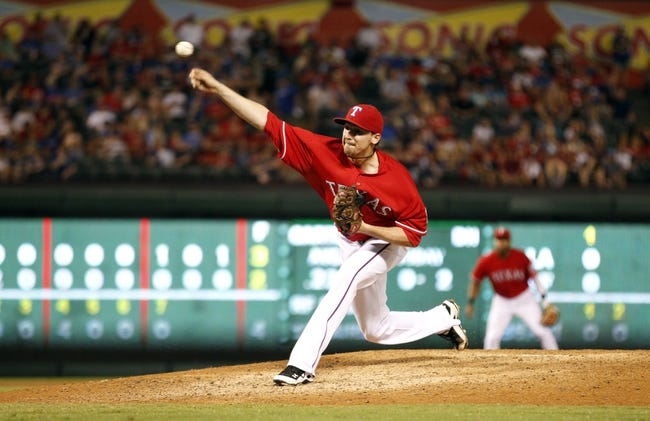 Sep 24, 2013; Arlington, TX, USA; Texas Rangers relief pitcher Tanner Scheppers (52) throws a pitch in the eighth inning of the game against the Houston Astros at Rangers Ballpark in Arlington. The Texas Rangers beat the Houston Astros 3-2. Mandatory Credit: Tim Heitman-USA TODAY Sports