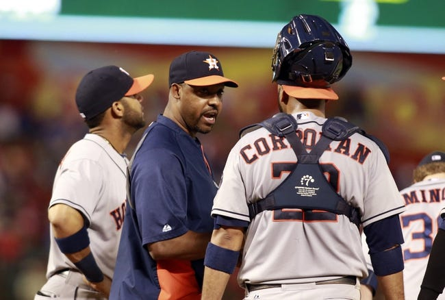 Sep 24, 2013; Arlington, TX, USA; Houston Astros manager Bo Porter (16) talks with Houston Astros catcher Carlos Corporan (22) in the seventh inning of the game against the Texas Rangers at Rangers Ballpark in Arlington. The Texas Rangers beat the Houston Astros 3-2. Mandatory Credit: Tim Heitman-USA TODAY Sports