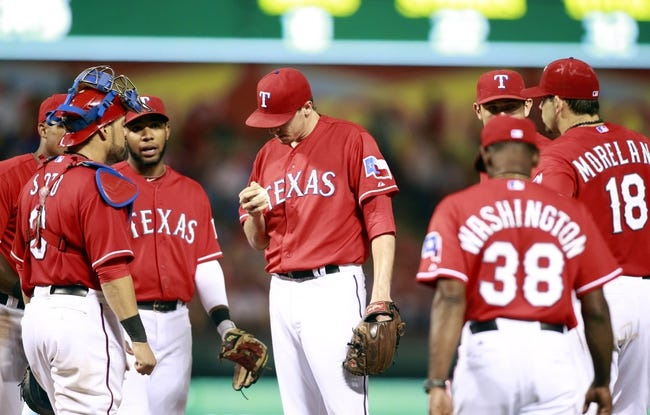 Sep 24, 2013; Arlington, TX, USA; Texas Rangers relief pitcher Tanner Scheppers (52) is relieved in the eighth inning of the game against the Houston Astros at Rangers Ballpark in Arlington. The Texas Rangers beat the Houston Astros 3-2. Mandatory Credit: Tim Heitman-USA TODAY Sports