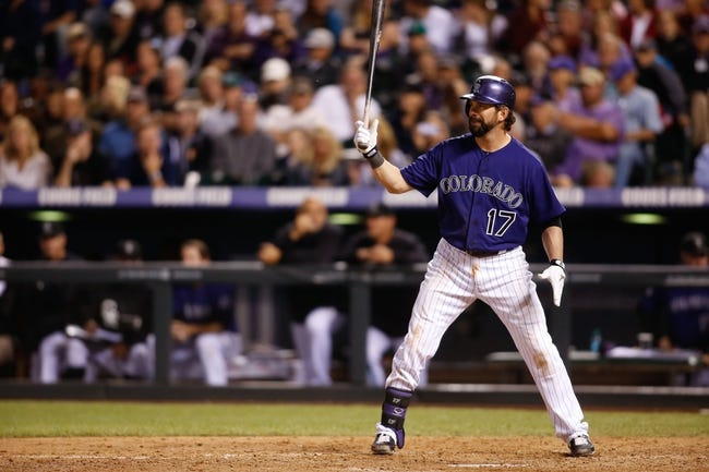 Sep 24, 2013; Denver, CO, USA; Colorado Rockies first baseman Todd Helton (17) at bat during the seventh inning against the Boston Red Sox at Coors Field. The Rockies won 8-3.  Mandatory Credit: Chris Humphreys-USA TODAY Sports