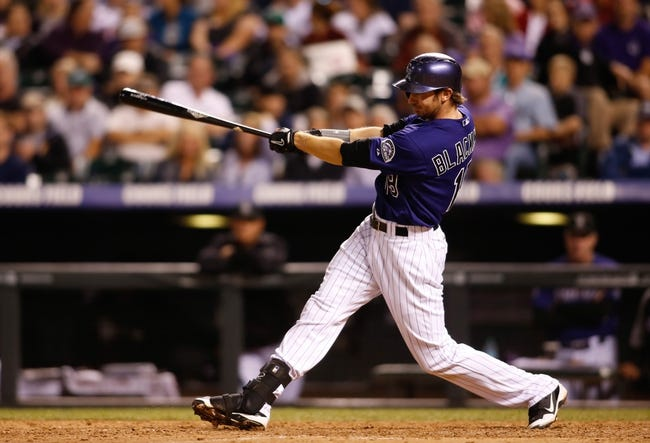 Sep 24, 2013; Denver, CO, USA; Colorado Rockies center fielder Charlie Blackmon (19) hits a single during the eighth inning against the Boston Red Sox at Coors Field. The Rockies won 8-3.  Mandatory Credit: Chris Humphreys-USA TODAY Sports
