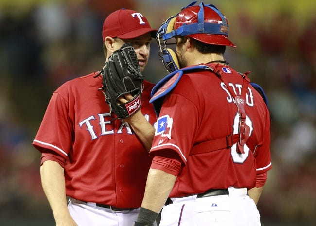 Sep 24, 2013; Arlington, TX, USA; Texas Rangers relief pitcher Jason Frasor (44) talks with catcher Geovany Soto (8) in the eighth inning of the game against the Houston Astros at Rangers Ballpark in Arlington. The Texas Rangers beat the Houston Astros 3-2. Mandatory Credit: Tim Heitman-USA TODAY Sports