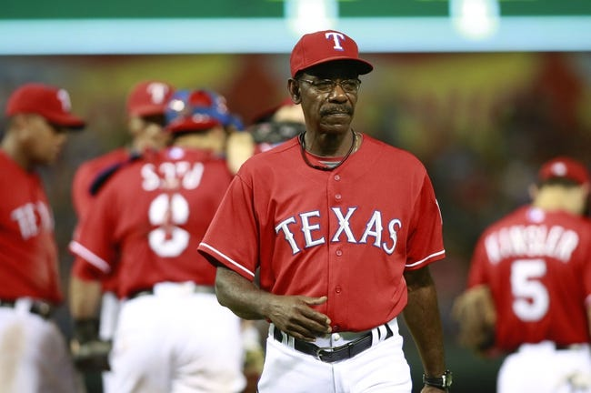 Sep 24, 2013; Arlington, TX, USA; Texas Rangers manager Ron Washington (38) walks back to the dugout after a pitching change in the eighth inning of the game against the Houston Astros at Rangers Ballpark in Arlington. The Texas Rangers beat the Houston Astros 3-2. Mandatory Credit: Tim Heitman-USA TODAY Sports