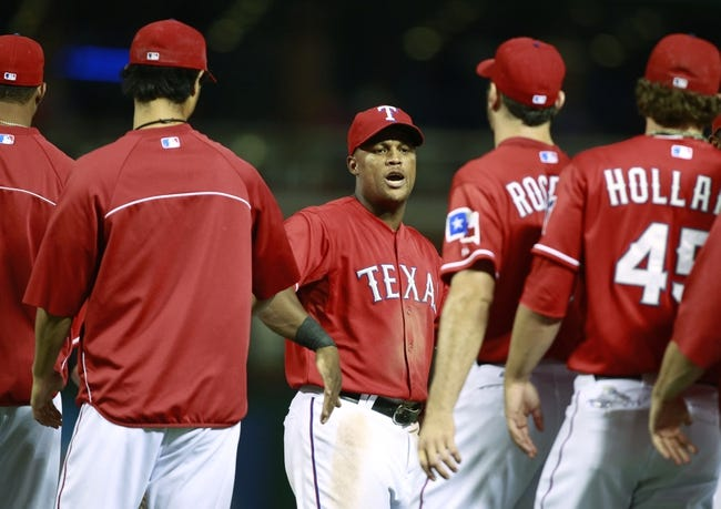 Sep 24, 2013; Arlington, TX, USA; Texas Rangers third baseman Adrian Beltre (29) is congratulated by his teammates after the game against the Houston Astros at Rangers Ballpark in Arlington. The Texas Rangers beat the Houston Astros 3-2. Mandatory Credit: Tim Heitman-USA TODAY Sports