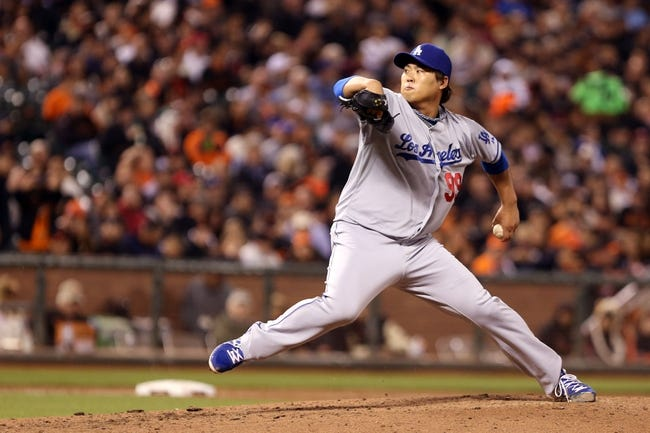 Sep 24, 2013; San Francisco, CA, USA; Los Angeles Dodgers starting pitcher Hyun-Jin Ryu (99) pitches the ball against the San Francisco Giants during the fifth inning at AT&T Park. Mandatory Credit: Kelley L Cox-USA TODAY Sports
