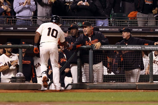 Sep 24, 2013; San Francisco, CA, USA; San Francisco Giants second baseman Tony Abreu (10) high fives manager Bruce Bochy (15) after hitting a solo home run against the Los Angeles Dodgers during the fifth inning at AT&T Park. Mandatory Credit: Kelley L Cox-USA TODAY Sports