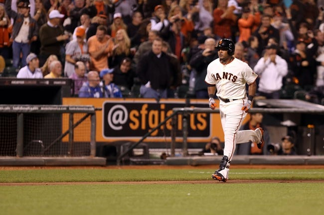 Sep 24, 2013; San Francisco, CA, USA; San Francisco Giants second baseman Tony Abreu (10) rounds the bases on a solo home run against the Los Angeles Dodgers during the fifth inning at AT&T Park. Mandatory Credit: Kelley L Cox-USA TODAY Sports
