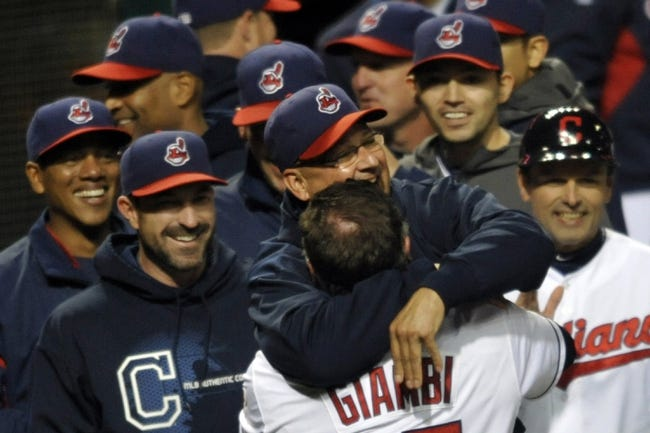 Sep 24, 2013; Cleveland, OH, USA; Cleveland Indians pinch hitter Jason Giambi celebrates with manager Terry Francona (center) after hitting a game-winning two-run home run in the ninth inning against the Chicago White Sox at Progressive Field. Mandatory Credit: David Richard-USA TODAY Sports