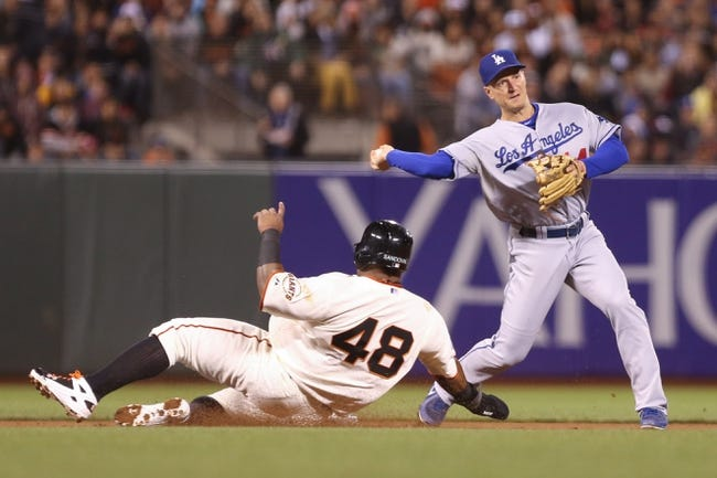 Sep 24, 2013; San Francisco, CA, USA; Los Angeles Dodgers second baseman Mark Ellis (14) makes the out against San Francisco Giants third baseman Pablo Sandoval (48) but is unable to turn a double play during the seventh inning at AT&T Park. Mandatory Credit: Kelley L Cox-USA TODAY Sports