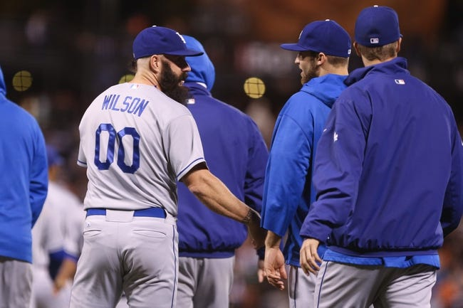 Sep 24, 2013; San Francisco, CA, USA; Los Angeles Dodgers relief pitcher Brian Wilson (00) celebrates the win with teammates after the game against the San Francisco Giants at AT&T Park. The Los Angeles Dodgers defeated the San Francisco Giants 2-1. Mandatory Credit: Kelley L Cox-USA TODAY Sports
