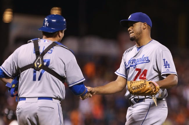 Sep 24, 2013; San Francisco, CA, USA; Los Angeles Dodgers relief pitcher Kenley Jansen (74) celebrates with catcher A.J. Ellis (17) after the win against the San Francisco Giants at AT&T Park. The Los Angeles Dodgers defeated the San Francisco Giants 2-1. Mandatory Credit: Kelley L Cox-USA TODAY Sports