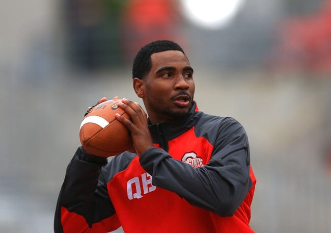 Sep 21, 2013; Columbus, OH, USA; Ohio State Buckeyes quarterback Braxton Miller (5) warms up prior to the game against the Florida A&M Rattlers at Ohio Stadium. Mandatory Credit: Andrew Weber-USA TODAY Sports