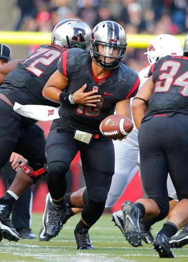 Sep 21, 2013; Piscataway, NJ, USA;  Rutgers Scarlet Knights quarterback Gary Nova (10) gets ready to hand the ball off to running back Paul James (34) during the first half against the Arkansas Razorbacks at High Points Solutions Stadium. Mandatory Credit: Jim O'Connor-USA TODAY Sports