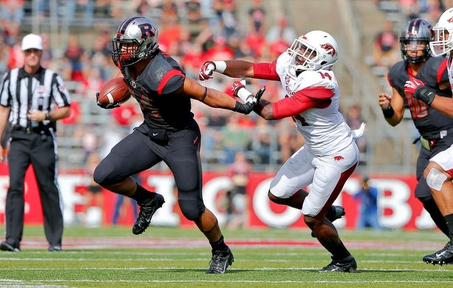 Sep 21, 2013; Piscataway, NJ, USA;  Rutgers Scarlet Knights running back Paul James (34) gets away from Arkansas Razorbacks safety Eric Bennett (14) during the first half as he picks up first down at High Points Solutions Stadium. Mandatory Credit: Jim O'Connor-USA TODAY Sports