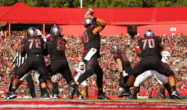 Sep 21, 2013; Piscataway, NJ, USA;  Rutgers Scarlet Knights quarterback Gary Nova (10) throws a pass during the first half against the Arkansas Razorbacks at High Points Solutions Stadium. Rutgers Scarlet Knights defeat the Arkansas Razorbacks 28-24. Mandatory Credit: Jim O'Connor-USA TODAY Sports