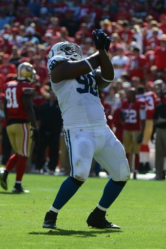 September 22, 2013; San Francisco, CA, USA; Indianapolis Colts defensive end Cory Redding (90) celebrates during the fourth quarter against the San Francisco 49ers at Candlestick Park. The Colts defeated the 49ers 27-7. Mandatory Credit: Kyle Terada-USA TODAY Sports
