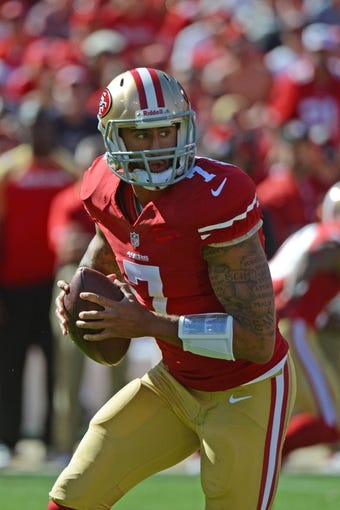 September 22, 2013; San Francisco, CA, USA; San Francisco 49ers quarterback Colin Kaepernick (7) looks for a receiver during the third quarter against the Indianapolis Colts at Candlestick Park. The Colts defeated the 49ers 27-7. Mandatory Credit: Kyle Terada-USA TODAY Sports