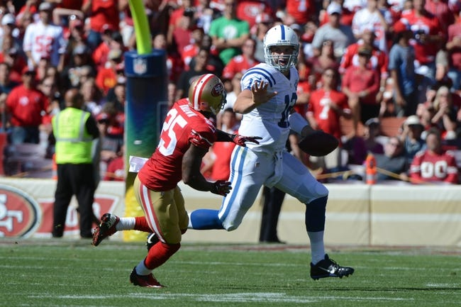 September 22, 2013; San Francisco, CA, USA; Indianapolis Colts quarterback Andrew Luck (12) runs against San Francisco 49ers cornerback Tarell Brown (25) during the third quarter at Candlestick Park. The Colts defeated the 49ers 27-7. Mandatory Credit: Kyle Terada-USA TODAY Sports