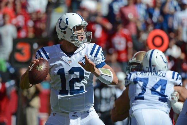 September 22, 2013; San Francisco, CA, USA; Indianapolis Colts quarterback Andrew Luck (12) looks for a receiver during the second quarter against the San Francisco 49ers at Candlestick Park. The Colts defeated the 49ers 27-7. Mandatory Credit: Kyle Terada-USA TODAY Sports