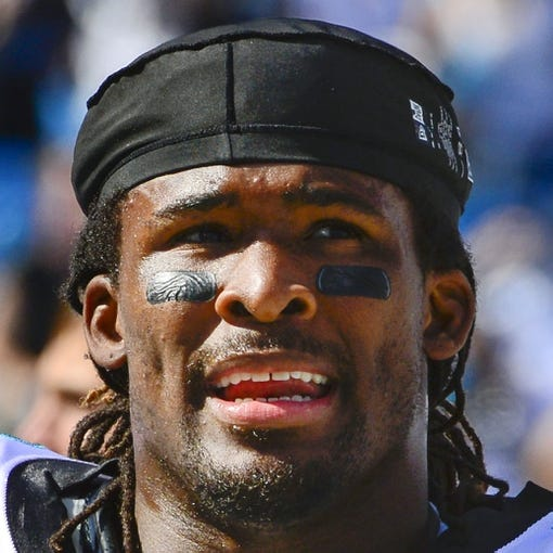 Sep 22, 2013; Charlotte, NC, USA; Carolina Panthers running back DeAngelo Williams (34) on the sidelines in the fourth quarter. The Carolina Panthers defeated the New York Giants 38-0 at Bank of America Stadium. Mandatory Credit: Bob Donnan-USA TODAY Sports