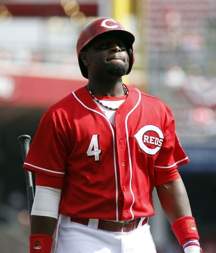 Sep 25, 2013; Cincinnati, OH, USA; Cincinnati Reds second baseman Brandon Phillips walks back to the dugout after striking out in the second inning during a game against the New York Mets at Great American Ball Park. Mandatory Credit: David Kohl-USA TODAY Sports
