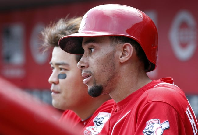 Sep 25, 2013; Cincinnati, OH, USA; Cincinnati Reds center fielder Billy Hamilton (right) and center fielder Shin-Soo Choo (left) watch from the dugout during a game against the Cincinnati Reds at Great American Ball Park. Mandatory Credit: David Kohl-USA TODAY Sports